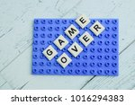Small photo of Word Game Over made of learning letters on plastic board.