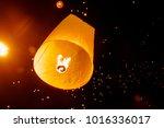 sky lantern ascending to light...   Shutterstock . vector #1016336017