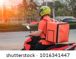 men deliver packets using... | Shutterstock . vector #1016341447