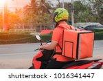 men deliver packets using... | Shutterstock . vector #1016341447