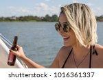 happy brazilian girl drinking... | Shutterstock . vector #1016361337