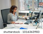 Small photo of Young Secretary with earphones work in office. Busy Girl with headset waist up, telemarketer communicate.