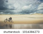 solitary bicycle on a solitary... | Shutterstock . vector #1016386273