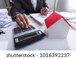 close up of a businessperson... | Shutterstock . vector #1016392237