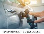 car detailing   man holds a... | Shutterstock . vector #1016500153