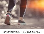 an athletic pair of legs going... | Shutterstock . vector #1016558767