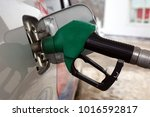 to fill the car with fuel. | Shutterstock . vector #1016592817
