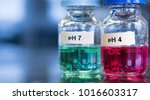 Small photo of pH 7 (green) and 4 buffer (red) solutions in glass bottles. These calibration solutions are commonly found in science laboratories where meters are used to measure sample acidity or alkalinity.