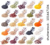 different legumes are scattered on a white background from glass bottles - stock photo