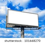 Blank billboard against bright blue sky - stock photo