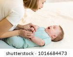 beautiful mother and her infant ... | Shutterstock . vector #1016684473