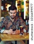 young bearded man wearing... | Shutterstock . vector #1016699977