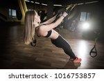 beautiful muscular woman doing... | Shutterstock . vector #1016753857
