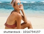 content restful female tourist... | Shutterstock . vector #1016754157
