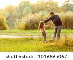 dad and daughter in the autumn... | Shutterstock . vector #1016865067