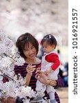 mother holding her child in her ...   Shutterstock . vector #1016921557