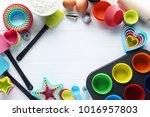 empty cupcake cases with... | Shutterstock . vector #1016957803