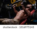 sexy strong bodybuilder... | Shutterstock . vector #1016975143