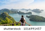 Small photo of Man tourist with backpack are looking at the beautiful natural landscape of the sea on peak view point of Ko Wua Ta Lap island in Mu Ko Ang Thong National Park, Surat Thani, Thailand, 16:9 Widescreen