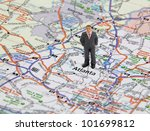 Business man figure standing on a map of Atlanta Georgia, USA. - stock photo