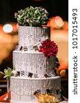 wedding cake at reception | Shutterstock . vector #1017015493