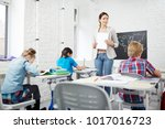 strict teacher walking along... | Shutterstock . vector #1017016723