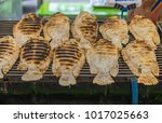 grilled fish for sale at a...   Shutterstock . vector #1017025663