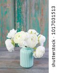 Small photo of White ranunculus flowers.