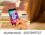girl holding a smartphone with... | Shutterstock . vector #1017045727