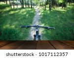 bike on the path in the park in ... | Shutterstock . vector #1017112357