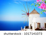 windmill of oia at sunny day... | Shutterstock . vector #1017141073
