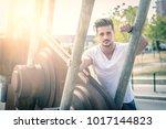 attractive man in urban setting ... | Shutterstock . vector #1017144823