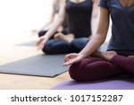women practicing yoga together... | Shutterstock . vector #1017152287