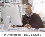 happy man wearing headphones... | Shutterstock . vector #1017152353
