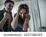 i will hit you. mad husband is... | Shutterstock . vector #1017186193
