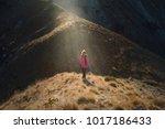 woman in purple jacket... | Shutterstock . vector #1017186433
