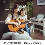 beautiful young mother with her ... | Shutterstock . vector #1017244393