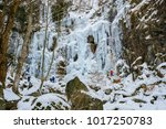 the ravine of an icy waterfall  ... | Shutterstock . vector #1017250783