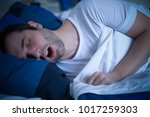 portrait of man sleeping and... | Shutterstock . vector #1017259303