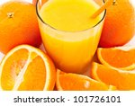 a cup of orange juice and fresh orange as a background - stock photo