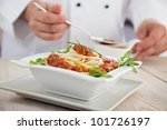male chef in restaurant kitchen ... | Shutterstock . vector #101726197