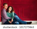 couple having fun while sitting ... | Shutterstock . vector #1017275863