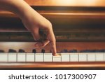 Small photo of Top view woman's hand playing and practice piano in musicroom at school. Favorite classical music.Show finger walking on piano keyboard.