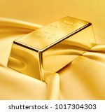 gold bar on satin fabric....   Shutterstock . vector #1017304303