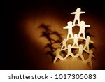 human team pyramid supporting... | Shutterstock . vector #1017305083