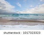 Small photo of Waves and snow squalls on Lake Michigan near Leland, Michigan
