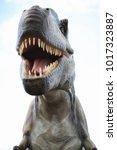 park of dinosaurs. a dinosaur... | Shutterstock . vector #1017323887