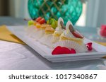 cake cut into pieces on the... | Shutterstock . vector #1017340867