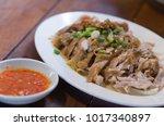 braised chicken chopped into... | Shutterstock . vector #1017340897