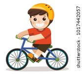 a cute boy riding a bicycle on... | Shutterstock .eps vector #1017442057